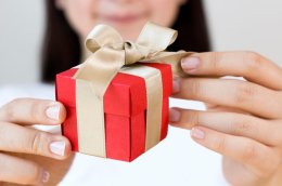 Woman Opening Red Gift Box